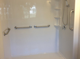 Shower widening to accomodate a wheelchair and replaced vanity with a wheelchair accessible vanity