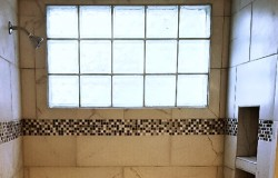 CUSTOM TILE SHOWER WITH MOSAIC TILE ACCENT