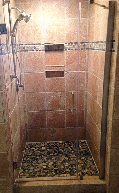 Incroyable AFTER: Custom Tile Shower With Mosaic Accent Tile And Pebble Stone Tile  Floor. Moen Brushed Nickel Fixtures. Glass Frameless Pivot Door